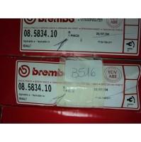 B516 - BREMBO 08.5834.10 COPPIA DISCHI POSTERIORI FRENO 7700780077 RENAULT CLIO